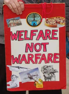 Welfare not warfare sign