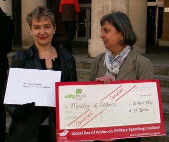 Kate Hudson, CND and Pat Gaffney, Pax Christi present 'cancelled' cheque to Ministry of Defence